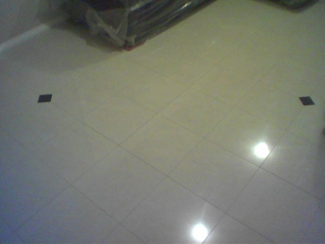 Polished Porcelain, Black granite insert. WE designed WE supplyed WE layed. Rtg